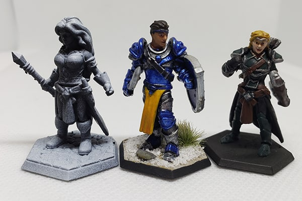 These are my Hero Forge Miniatures. Here they are in various stages of their development. 2 are almost done and 1 is primed.