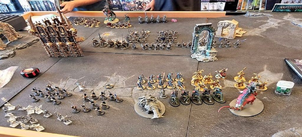 A table with Warhammer miniatures