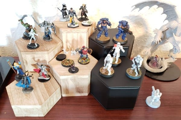 I use risers to display my painted miniatures