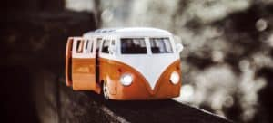Scale model of an orange and white VW bus