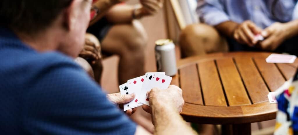 Men Playing The Card Game Bullshit