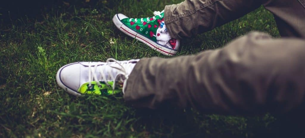 Laying in the grass with freshly painted sneakers