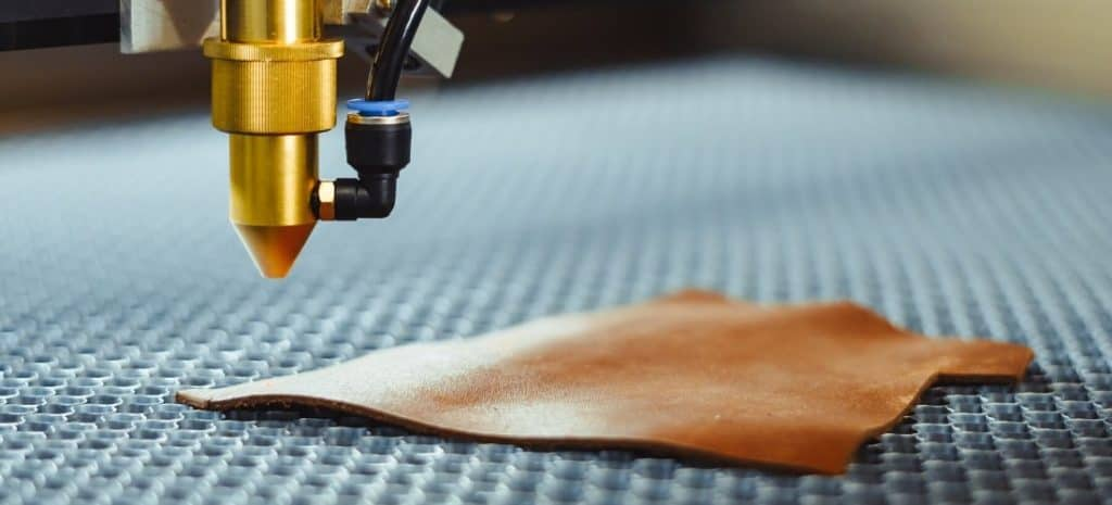 A laser about to burn a design into leather
