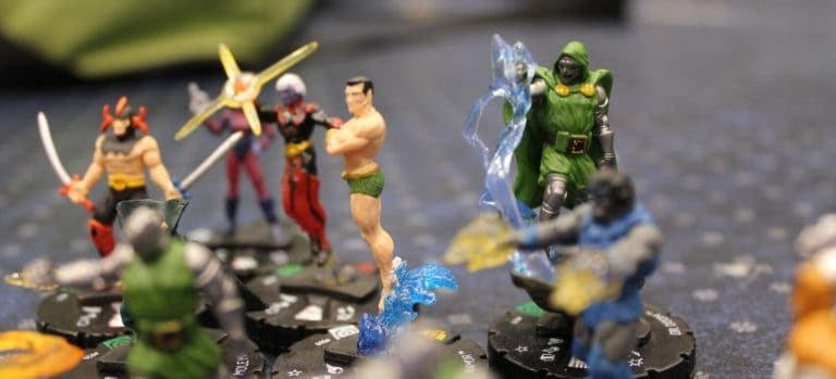 HeroClix Tabletop Miniatures on a Gaming Mat