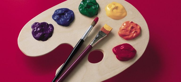 Paint palette with six paint colors and red background.