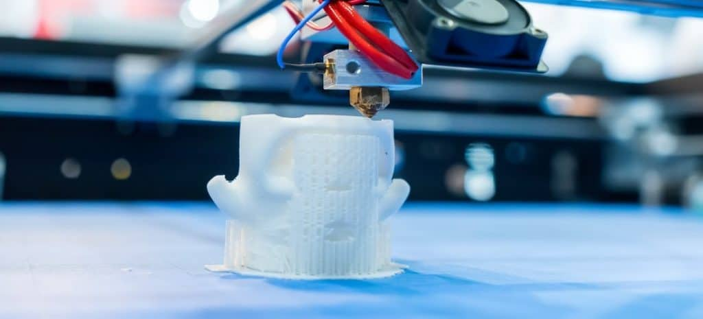 3D printer printing a white structure.