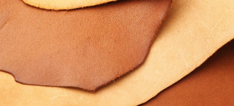 Four pieces of recently tanned leather.