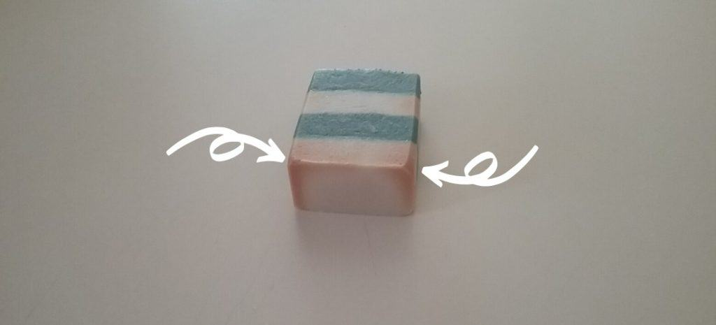 Blue and white striped soap with dreaded orange spots.