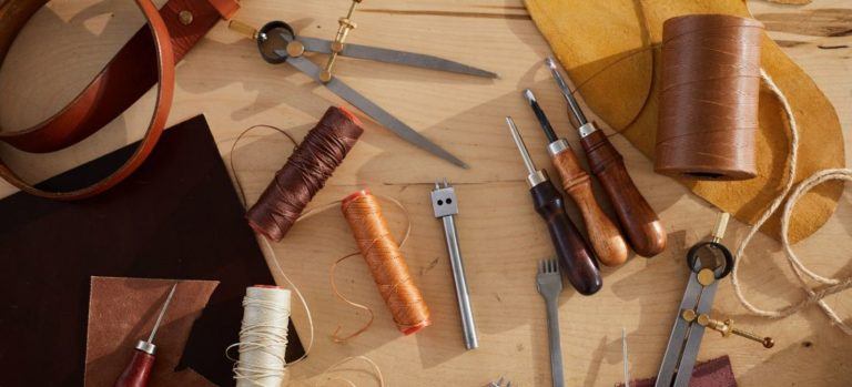 An assortment of tools used in leatherworking.