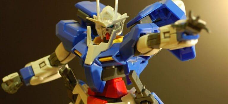 Top half of a blue and beige Gundam model.