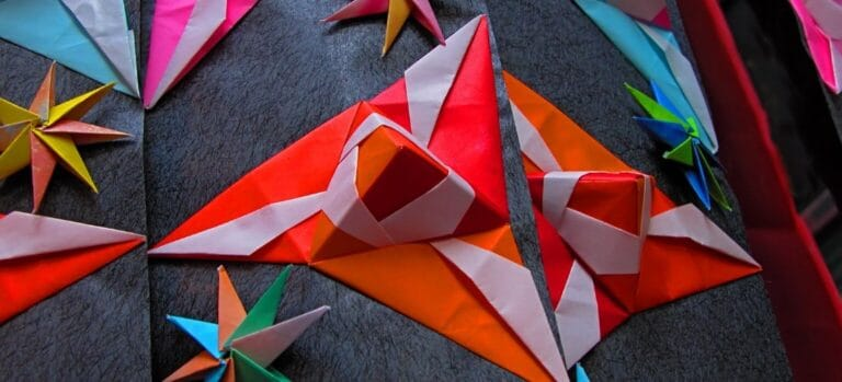 Several different, colorful origami models.
