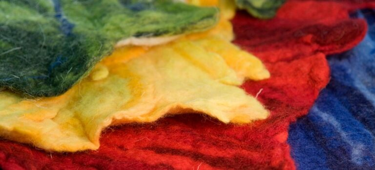 Green, yellow, red, and blue pieces of felt.