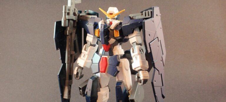 Upper half of a gray and white Gundam model.