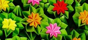Bright, colorful origami flowers.