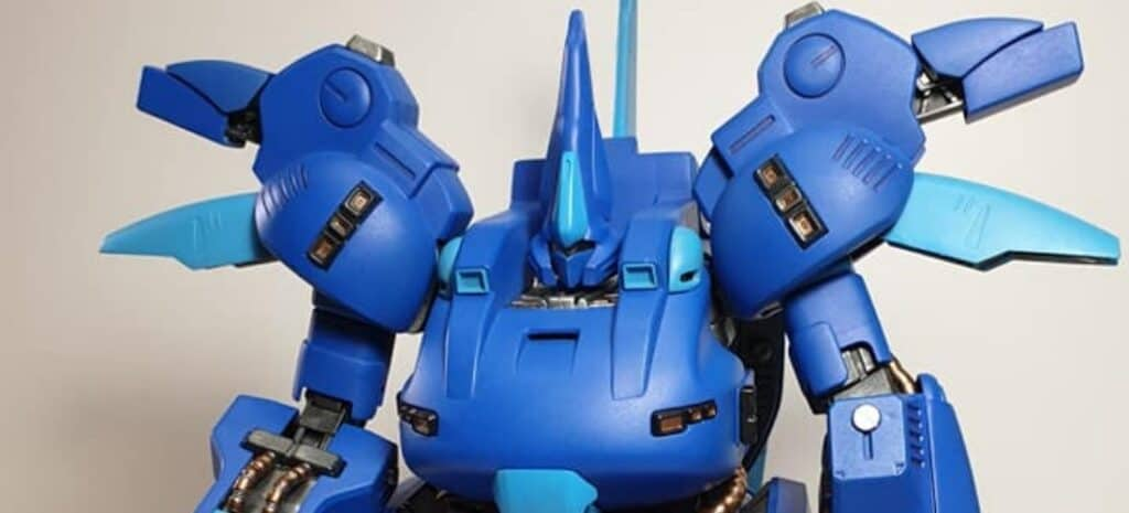 A dark blue Gundam model with light blue highlights.