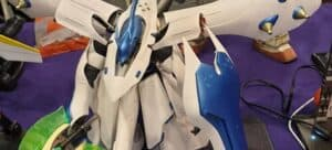 A white and blue Gundam model under construction.