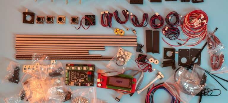 Various parts for an electronic STEM kit laid out on a table.