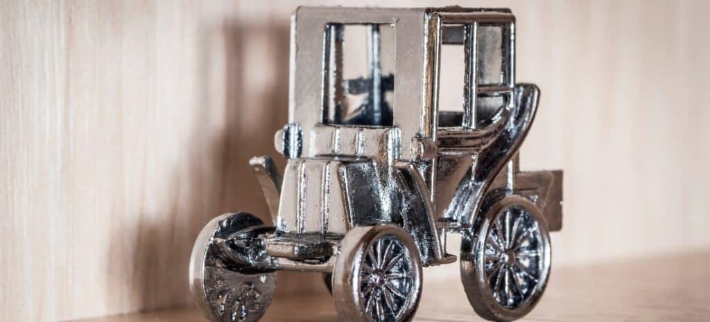 An older model metal model car.