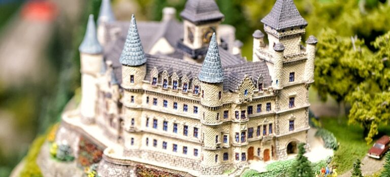 A large, detailed model of a castle, complete with blue spires and painted windows.