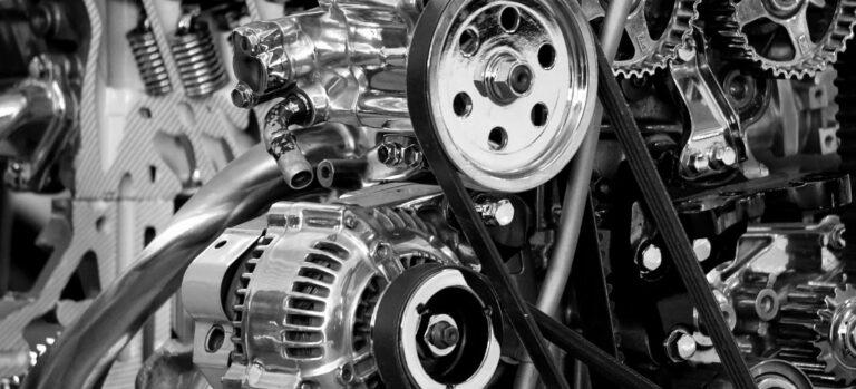 A closeup of a gleaming car engine.