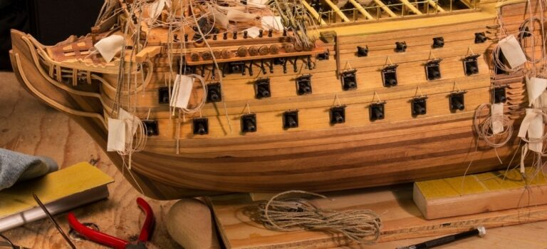 A wooden model ship complete with rigging.