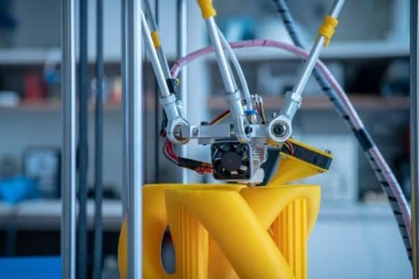 Bright yellow parts of a Delta 3D printer.