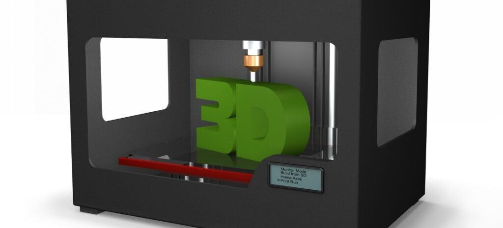 "A black, rectangular 3D printer printing out green ""3D."""