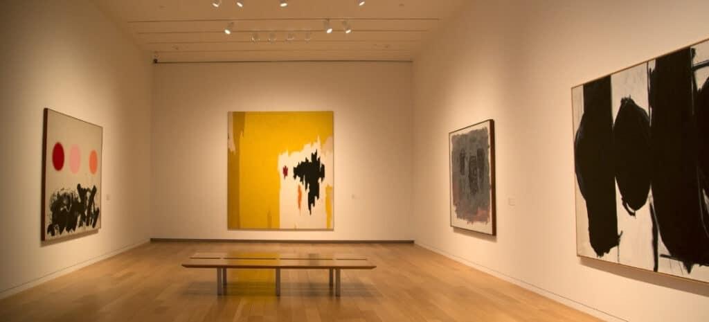Four modern art paintings in an art museum in Texas.